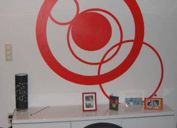 Muurschildering van abstracte rode cirkels