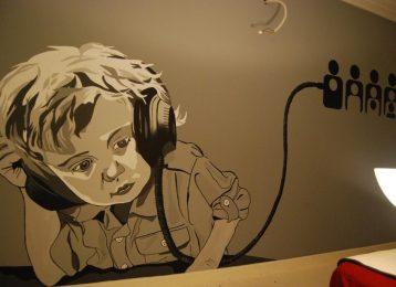 Muurschildering van een DJ