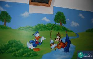 muurschildering Donald en Goofy aan rivier