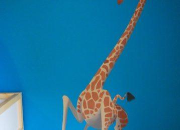 Muurschildering Melman de giraffe uit Madagascar