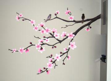 Muurschildering rozentak met een vogeltje er op